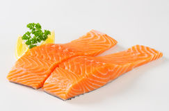 Raw salmon fillets Royalty Free Stock Photos