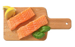 Raw salmon fillets. Two salted salmon fillets on wooden cutting board Stock Images