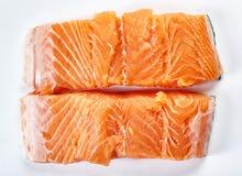 Raw salmon fillets on white Stock Photos