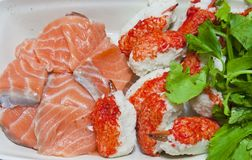 Raw salmon fish and claw crab Royalty Free Stock Images