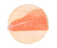 Raw salmon fish on cutting board. Isolated on a white background Stock Photos