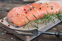 Raw Salmon Fish Fillet with Fresh Herbs. On Cutting Board Royalty Free Stock Image