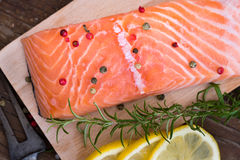Raw Salmon Fish Fillet with Lemon and Fresh Herbs Stock Image