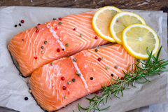 Raw Salmon Fish Fillet with Lemon, Spices and Fresh Herbs Stock Image