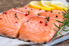 Raw Salmon Fish Fillet with Lemon, Spices and Fresh Herbs Royalty Free Stock Images