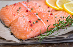 Raw Salmon Fish Fillet with Lemon, Spices and Fresh Herbs Royalty Free Stock Photos