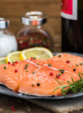 Raw Salmon Fish Fillet with Wine, Lemon, Spices and Fresh Herbs. On Plate Stock Photo