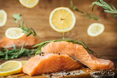 Raw salmon fish fillet on wooden background. Stock Photography