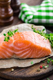 Raw salmon fish fillet on wooden board Royalty Free Stock Photography