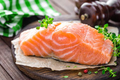 Raw salmon fish fillet on wooden board Royalty Free Stock Image
