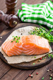 Raw salmon fish fillet on wooden board Stock Images
