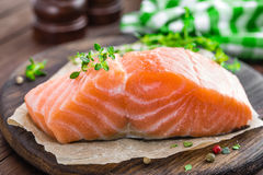 Raw salmon fish fillet on wooden board Royalty Free Stock Images