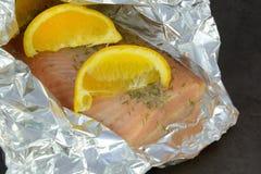 Raw salmon fish fillets on baking tray Stock Photos