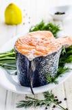 Raw salmon fish. With fresh herbs and lemon Stock Photos