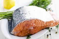 Raw salmon fish. With fresh herbs and lemon Royalty Free Stock Photo