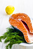 Raw salmon fish. With fresh herbs and lemon Stock Image