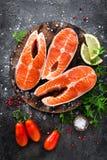 Raw salmon fish. Fresh salmon steaks. Top view royalty free stock photos