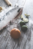 Raw salmon fish in ice and vegetables. On white table. Baking paper Stock Images