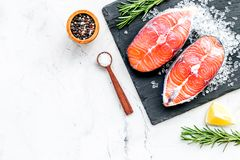 Free Raw Salmon Fish On Black Plates For Cooking Steaks On Marble Restaurant Kitchen Background Top View Space For Text Royalty Free Stock Photos - 134817458