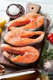 Raw salmon fish steaks. With spices cooking on cutting board. Top view Stock Images