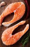 Raw salmon fish steaks. With spices cooking on cutting board. Top view Stock Photography
