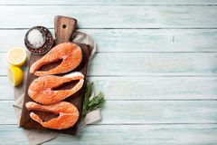 Raw salmon fish steaks. With spices cooking on cutting board. Top view with space for your text Stock Images