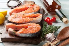 Raw salmon fish steaks. With spices cooking on cutting board Stock Images
