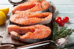 Raw salmon fish steaks. With spices cooking on cutting board Royalty Free Stock Image