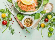 Raw salmon  with fresh vegetables and herbs , preparation for cooking on green wooden background Royalty Free Stock Images