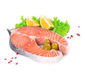 Raw salmon with garnish. Isolated on a white background Stock Images