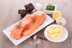 Raw salmon and ingredient. On wood Royalty Free Stock Photography