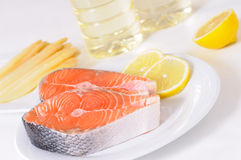 Raw salmon with lemon Stock Photography