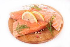 Raw salmon. And lemon on board Stock Photos