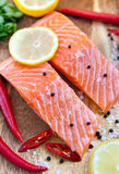 Raw salmon with lemon and pepper Stock Image