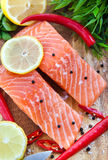 Raw salmon with lemon and pepper Stock Photos