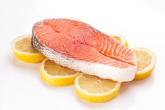 Raw salmon on lemons  in target Royalty Free Stock Images