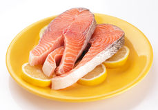 Raw salmon on lemons in yellow plate. Stock Images