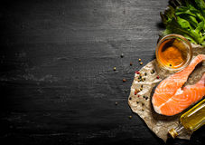 Raw salmon with olive oil, spices and herbs. Stock Photo