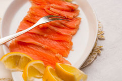 Raw salmon on plate Stock Images