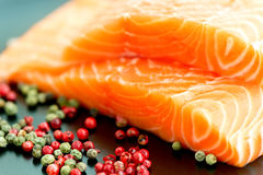 Raw salmon ready to cook close up on black surface Stock Image