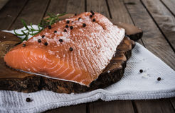 Raw salmon with salt and pepper Stock Photography