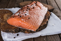 Raw salmon with salt and pepper Royalty Free Stock Images
