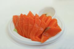 Raw salmon sashimi on white plate - Japanese food.  Stock Photo