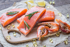 Raw salmon with shrimps on the wooden board Stock Photography