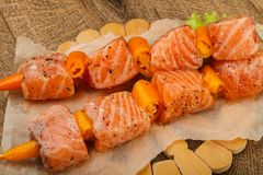 Raw salmon skewer. With spices ready for cooking Stock Photo