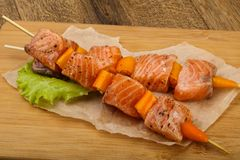Raw salmon skewer. With spices ready for cooking Royalty Free Stock Photo