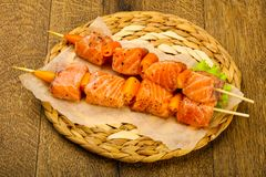 Raw salmon skewer Stock Photos