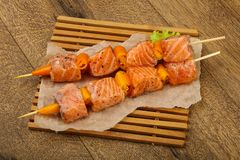 Raw salmon skewer. With spices ready for cooking Stock Photos