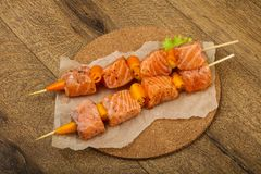 Raw salmon skewer. With spices ready for cooking Stock Image