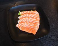 Raw salmon slice or salmon sashimi in Japanese style fresh serve in bowl at Japanese. Raw salmon slice or salmon sashimi in Japanese style fresh serve on bowl Royalty Free Stock Photos